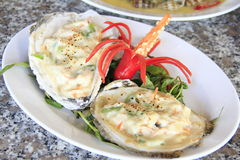 Fried oyster with cheese and chili, vegetables on white plate. Deliciously Royalty Free Stock Photos