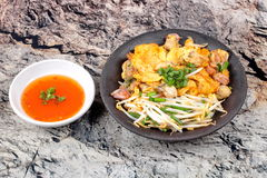 Fried oyster omelet with herb call Hoi Tod Khai. Stock Photo