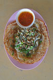 Fried oyster omelette with chili sauce on small mini saucer Royalty Free Stock Photography