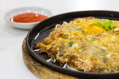 Fried oysters with egg and flour chilli sauce on hot plate Stock Photos
