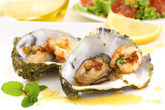 Fried oysters and prawns in a shell Stock Photos