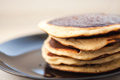 Fried pancakes on a black plate, close-up royalty free stock photo