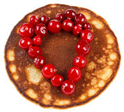 Fried pancakes with cranberries in heart shape isolated on white Stock Photography