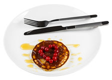 Fried pancakes with cranberries in heart shape isolated on white Royalty Free Stock Photography