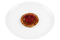 Fried pancakes with cranberry heart shaped with honey on a plate Stock Photo