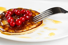 Fried pancakes with cranberry heart shaped with honey on a plate Stock Image