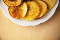 Fried pancakes on old wooden table. Top view Stock Image