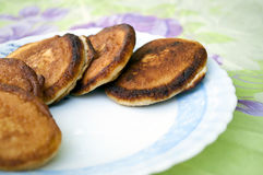 Fried pancakes. Some pancakes on a plate, fried pancakes on the table Royalty Free Stock Photos
