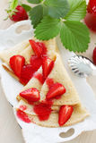 Fried pancakes with strawberries Royalty Free Stock Photos