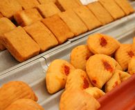 Fried panzerotti and bread sold at the market Stock Images