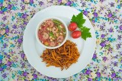 Fried papaya salad. On background royalty free stock images