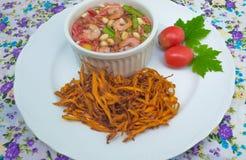 Fried papaya salad. On background royalty free stock photo