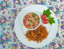 Fried papaya salad. On background royalty free stock image