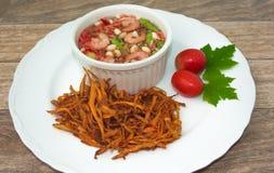 Fried papaya salad. On wood background royalty free stock images