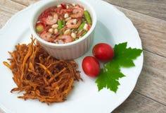 Fried papaya salad. On wood background royalty free stock photos