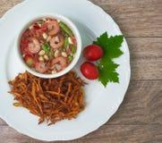 Fried papaya salad. On wood background Royalty Free Stock Photo