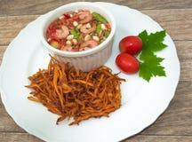 Fried papaya salad. On wood background royalty free stock photography