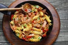 Fried pasta with pork ham Stock Image
