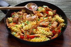 Fried pasta with pork ham Stock Image