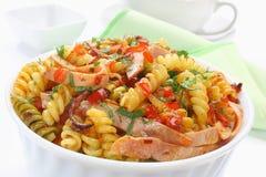 Fried pasta with pork ham Stock Photo