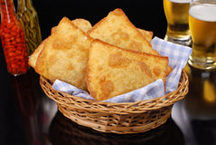 Fried Pastel in a basket in black background Royalty Free Stock Images