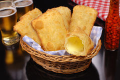 Fried Pastel in basket in  black background with one open Stock Photos