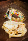 Fried pastry of italian carnival with venetian mask. Stock Photography