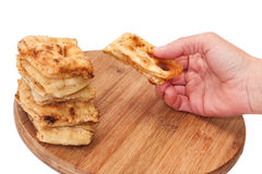 Fried patella on the board and in hand Royalty Free Stock Images