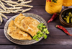 Fried patties with potatoes and liver. On a dark background Stock Photography