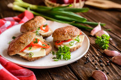 Fried patty filled with cheese, egg, bell pepper and scallion Stock Images