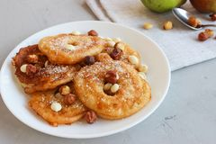 Fried pear donuts. Pear donuts with fried hazelnuts and ice cream royalty free stock photo