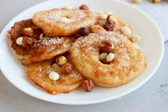 Fried pear donuts. Pear donuts with fried hazelnuts and ice cream royalty free stock photography