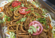 Fried pepper squid at an indian restaurant buffet Stock Photography