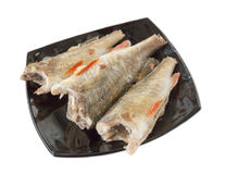 Fried perch on a black plate. Fish on a black plate Stock Photography