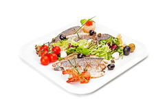 Fried pieces of fish, served by vegetable & shrimps. Royalty Free Stock Image