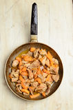 Fried pieces of meat and pumpkin in a pan Royalty Free Stock Photography