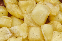 Fried pieces of potatoes Stock Photography
