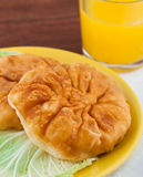 Fried pies with cabbage. On the plate with juice Royalty Free Stock Photography