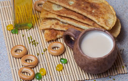 Fried pies, cheese, sunflower oil, milk and bagels on a plate cl Royalty Free Stock Photo