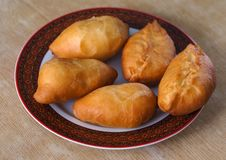 Fried pies with potatoes stock photography