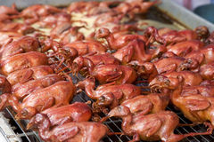 Fried Pigeons. A Chinese specialty of deep fried pigeons ready for sale at the market Royalty Free Stock Photo