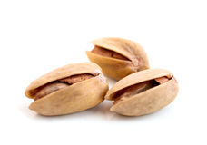 Fried pistachios. On a white background Stock Photography