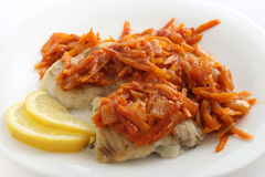 Fried plaice with carrot Stock Photo