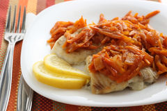 Fried plaice with carrot and lemon Stock Photos