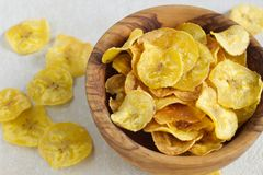 Fried plantain chips in a wooden bowl. Royalty Free Stock Images