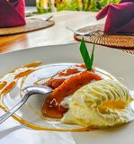 Fried Plantain and Ice Cream Dessert From Bali. Fried Plantain and French Vanilla ice cream dessert served in Bali, Indonesia Royalty Free Stock Image