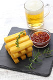 Fried polenta and beer Stock Photography