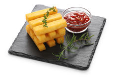 Fried polenta with dipping sauce Stock Images
