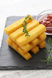 Fried polenta with dipping sauce Stock Photo