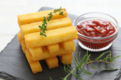 Fried polenta with dipping sauce Royalty Free Stock Images